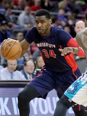 Detroit Pistons' Quincy Miller (34) drives against Charlotte Hornets' Troy Daniels (30).