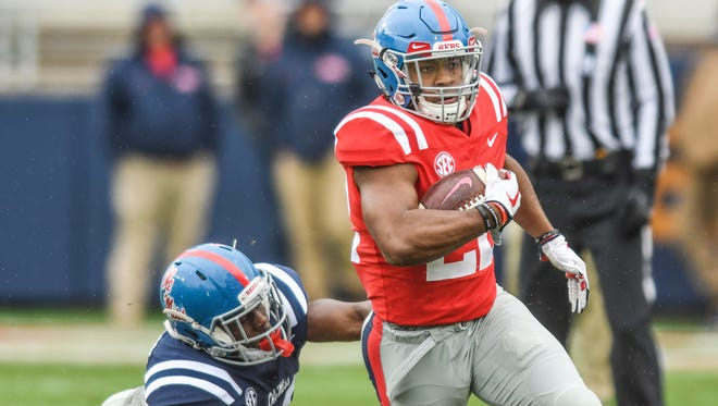 Ole Miss running back Scottie Phillips (22) is chased by C.J. Moore (38) during the Grove Bowl spring NCAA college football game at Vaught-Hemingway Stadium in Oxford, Miss. on Saturday, April 7, 2018.
