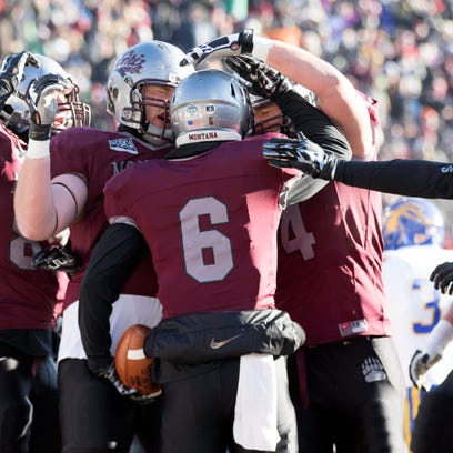Montana running back John Nguyen (20) rushes against South Dakota State during the first half of a first round game in the NCAA college Football Championship Subdivision playoff, Saturday, Nov. 28, 2015, in Missoula, Mont. (AP Photo/Patrick Record)