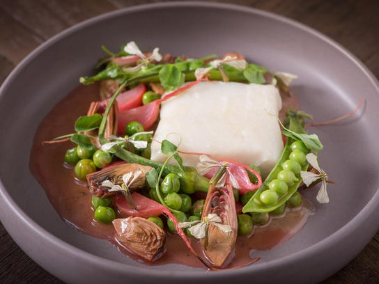 Olive-oil poached halibut with English peas and foraged