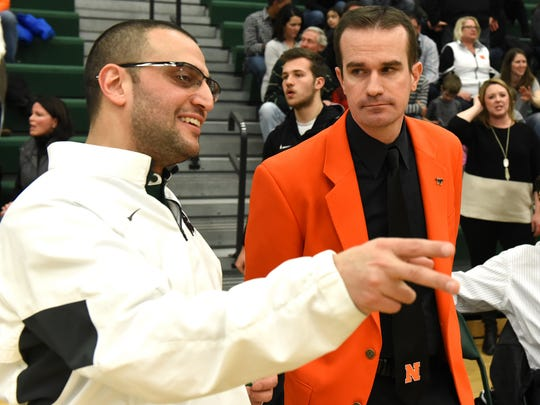 Novo coach Brandon Sinawi (left) and Northville's Todd Sander chat before Friday night's game.