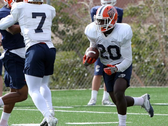 UTEP running back Joshua Fields, 20, takes the hand-off at Tuesday's practice at Glory Field.