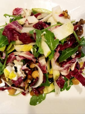 LouRonzo's house salad is a blend of the freshest Belgium endive, radicchio, arugula, goat cheese, garbanzo beans, dried currants, candied walnuts and Anjou pear, with a champagne vanilla bean vinaigrette.