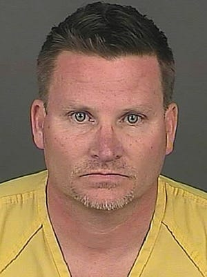 Richard Kirk, 47, of Denver is accused of killing his wife while she was on the phone with emergency dispatchers to get medical help for him.