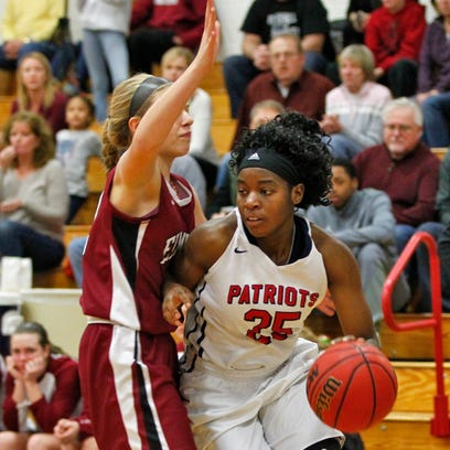 Binghamton's Olivia Ramil, left, and Elmira's Jaida Washington battle for possession in Friday's  STAC girls basketball championship game. Ramil scored 21 points and grabbed 14 rebounds to lead the Patriots to a 60-47 win.