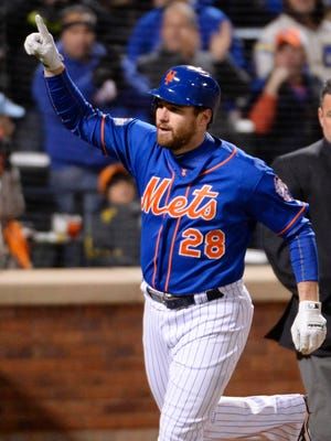 Mets second baseman Daniel Murphy reacts after hitting a solo home run in the first inning of Game 1 of the NLCS.