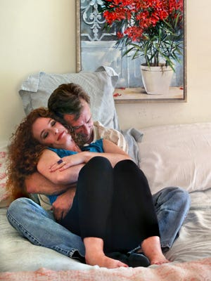 Lisa Kelly of Carmel has started Indy Cuddles, a professional cuddling service in which she cuddles with clients. Fees range from $35 for a 30-minute session to $60 for a 60-minute session. She is shown here cuddling with Dan Harris of Springfield, Ohio, in the Momma Bear-Poppa Bear position on Oct. 1.