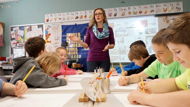 """Crestview Elementary seccond grade teacher Anne DaHinden works with her students, revisiting the """"The Asian Experience"""" unit for which she won the Kennedy Center for the Performing Arts Partners in Education program 2016 North Central Ohio Creative Teacher Award."""