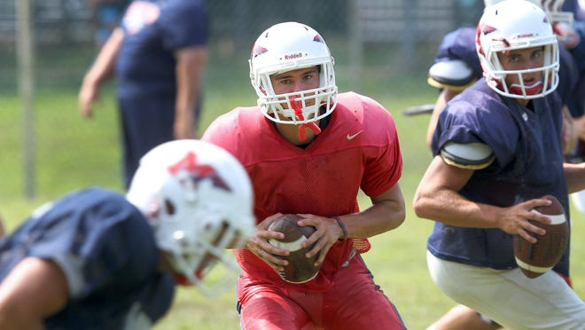 Manalapan Quarterback Luke Corcione runs drills with his team mates during a scrimmage with Colts Neck at home Thursday, August 27, 2015.