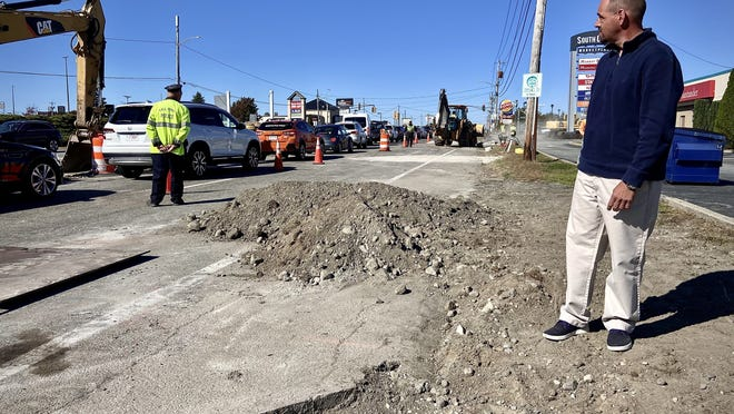John Perry, director of the Department of Community Development, stands next to William S. Canning Boulevard where a new entrance lane for the Southcoast Marketplace is being added.