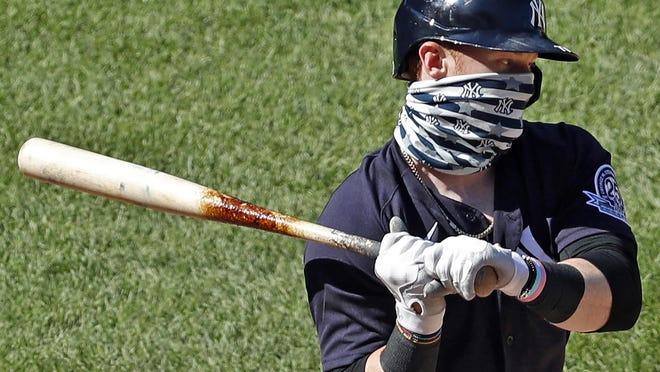 New York Yankees' Clint Frazier wears a face mask while batting during an intrasquad game in baseball summer training camp Sunday at Yankee Stadium in New York.