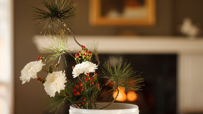 An ikebana arrangement by Eileen Kay, of Boulder, Colorado, in a Snow Basin Suiban round vase. Kay teaches ikebana and meditation. Ziji.com is an online store selling supplies for ikebana flower arranging and other Japanese arts.