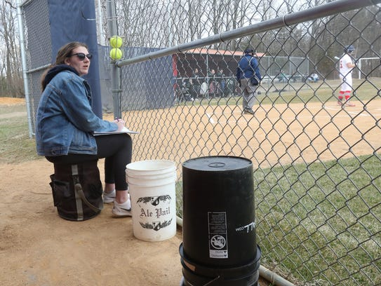 Helena Van BenSchoten watches her sister at bat during