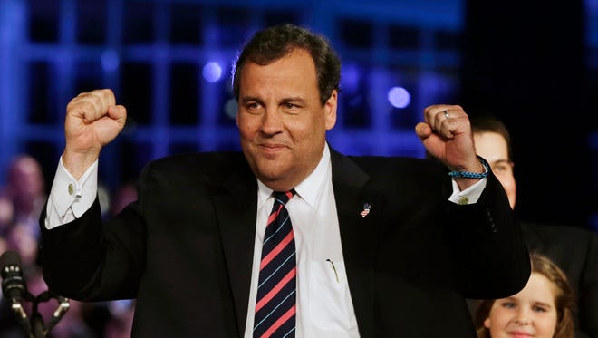 New Jersey Gov. Chris Christie, a Republican, celebrates winning a second term.
