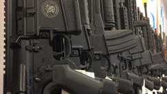 AR-15 rifles are displayed for sale at Guns and Leather