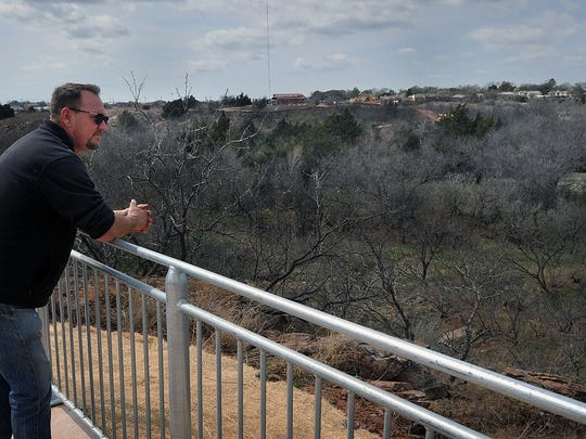 Mark Hamett, an inspector for the cfity of Wichita Falls, stops at one of several scenic overlooks in the Wichita Bluff Nature Area. The next segment of the Circle Trail is in the area and promises to be the most picturesque.