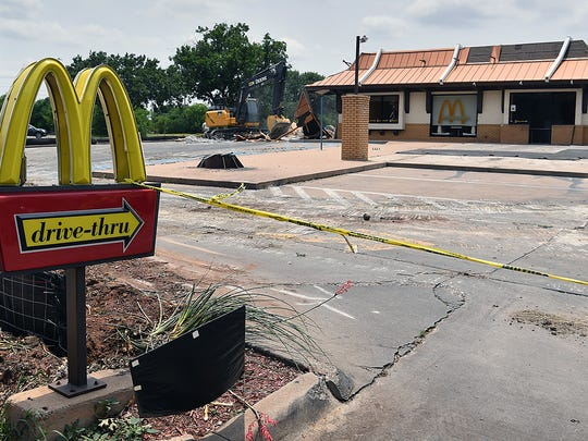 Demolition has begun at the old McDonalds building on Holliday. The franchise will reopen with a newer, larger restaurant in the same location with two drive-thru lanes and high-tech kitchen.