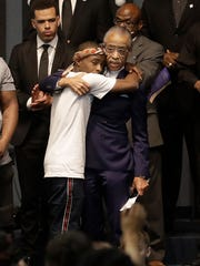 The Rev. Al Sharpton, right, hugs Stevante Clark during the funeral services for police shooting victim Stephon Clark at Bayside of South Sacramento Church.