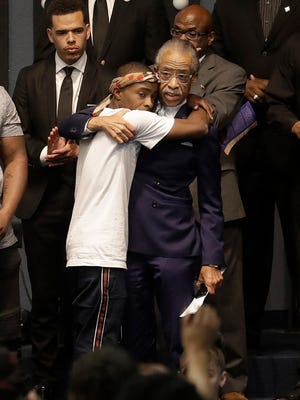 Rev. Al Sharpton (right) hugs Stevante Clark during the funeral services for police shooting victim Stephon Clark at Bayside Of South Sacramento Church in Sacramento, Calif.