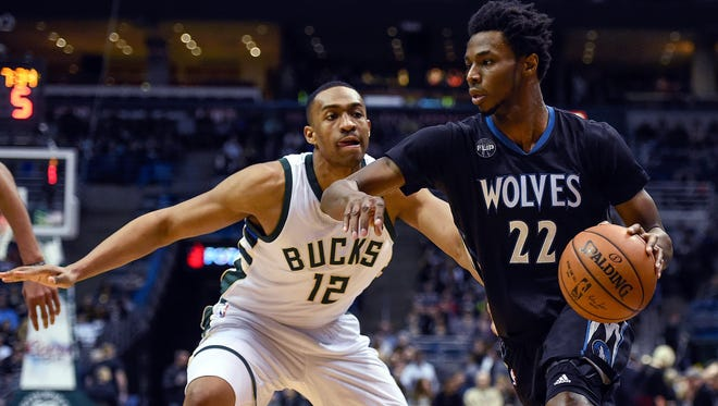 Minnesota Timberwolves guard Andrew Wiggins drives for the basket against Milwaukee Bucks forward Jabari Parker  at the BMO Harris Bradley Center. The top two picks in the 2014 draft (Wiggins No. 1 and Parker No. 2) will square off again in Minneapolis.