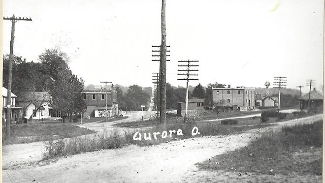 The depot can be seen on the right edge of this photo of the Aurora Station District. Treat's store and lumber and coal yards can be seen across the tracks from the depot. Hurd's store is across the winding East Garfield Rd.