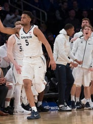Xavier guard Trevon Bluiett gestures after scoring a basketbal during the second half of an NCAA college basketball game against St. John's in the quarterfinals of the Big East conference tournament, Thursday, March 8, 2018, at Madison Square Garden in New York. Xavier won 88-60. (AP Photo/Mary Altaffer)