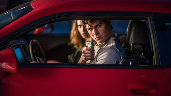 Baby (Ansel Elgort) goes to extremes to keep Debora (Lily James) safe in 'Baby Driver.'