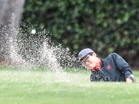 Palm Desert's John Kim hits his ball out of the bunker on 9 during the 2018 CIF State Boys High School Championship played at San Gabriel Country Club on Wednesday, May 30, 2018 in San Gabriel. Palm Desert lost the team title by one shot.