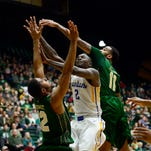 CSU's Carlton Hurst, left, and Stanton Kidd work together to block a shot by San Jose State's Jaleel Williams during Wednesday night's game at Moby Arena.