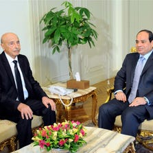In this photo provided by Egypt's state news agency, MENA, speaker of the Libyan Parliament Ageila Saleh Eissa, left, meets Egyptian President Abdel-Fattah el-Sissi at the presidential palace in Cairo, Egypt, on Aug. 26, 2014. A delegation of Libyan officials are visiting Egypt amid increasing fears among Libya's neighbors and Western countries that the North African nation is sliding deeper into turmoil.