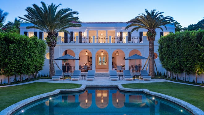Villa Primavera at dusk with its distinctive pool and shades of blue outdoor furniture that echo the interiors.