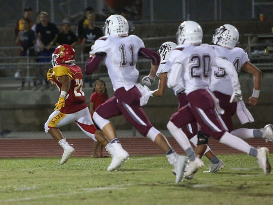 Palm Desert back Manny Sepulveda runs for a first half touchdown against Rancho Mirage, September 15, 2017.