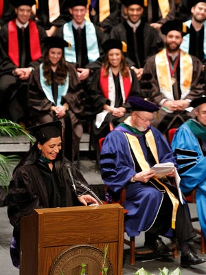 Dr. Mona Khanna delivers a commencement address recently at her alma mater, the University of Illinois College of Medicine in Rockford, Ill.