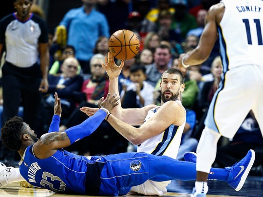 "Memphis Grizzlies center Marc Gasol (middle) makes a pass to teammate Mike Conley (right) as Dallas Mavericks""s Wesley Matthews (left) defends on the play during fourth quarter action at the FedExForum in Memphis, Tenn., Thursday, October 26, 2017."