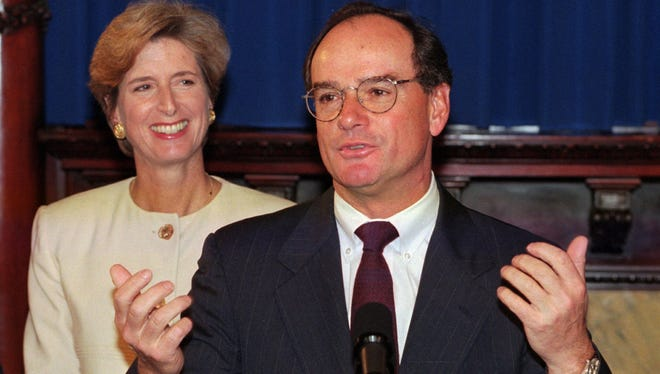 """Donald DiFrancesco, right, responds to a question after Gov. Christie Whitman, left, signed into law the """"state mandate-state pay"""" legislation during ceremonies in Trenton, Wednesday, May 8, 1996."""