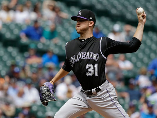 Colorado Rockies starting pitcher Kyle Freeland throws against the Seattle Mariners in the first inning of a baseball game, Thursday, June 1, 2017, in Seattle. (AP Photo/Ted S. Warren)