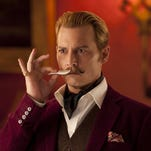 "Johnny Depp plays Charlie Mortdecai, a British art dealer tasked with finding a stolen painting, in ""Mortdecai."""
