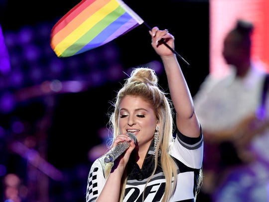Meghan Trainor waves a rainbow flag onstage during the 2018 iHeartRadio Wango Tango concert on June 2 in L.A.