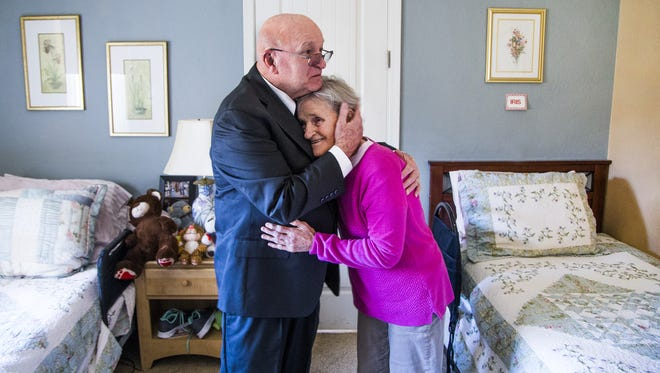 Bob McGuire visits his wife, Linda, in her room at Atlantis II Adult Care Home in Goodyear on Feb. 6, 2018. McGuire is fighting the legal costs he's had to pay as he tries to tap his wife's IRA to help pay for medical costs after she was diagnosed with dementia.