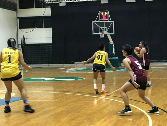 Fuetsa Basketball Club, in black, is shown in this file photo. Fuetsa beat the Lady Tridents 97-44 in the Trident Women's Basketball League 2.5 Thursday.
