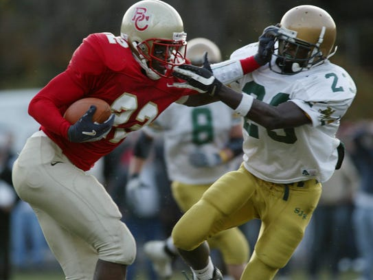 Devin McCourty, right, playing for St. Joseph's in