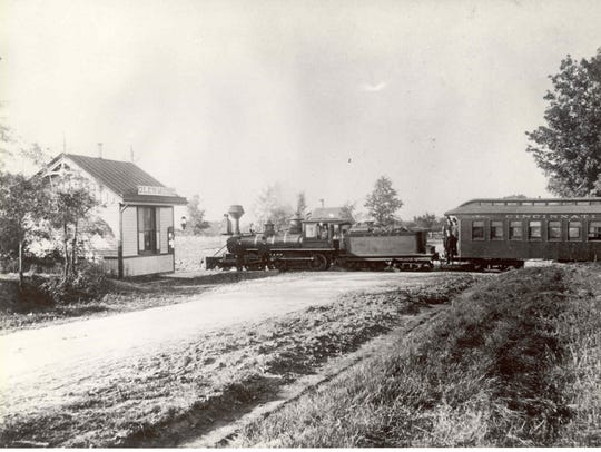 A historical photograph shows a train crossing Glenmore Avenue. The picture was likely taken around 1887. The Westwood Historical Society is looking for old photographs as part of Westwood's 150th anniversary celebration this year.