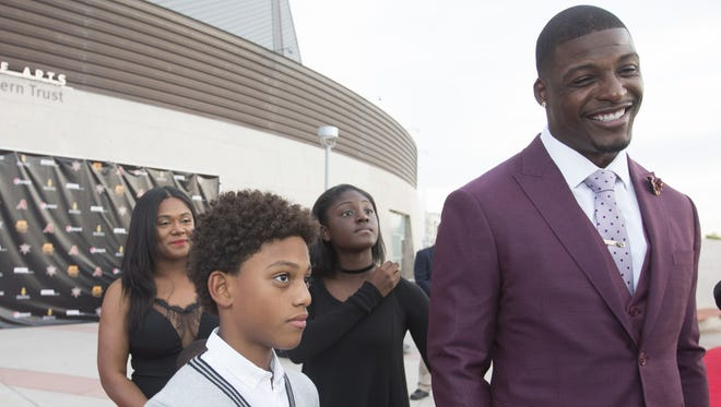 Arizona Cardinals safety Adrian Wilson answers questions from the media on the red carpet during the Arizona Sports Hall of Fame ceremony at Tempe Center for the Arts on October 27, 2016.