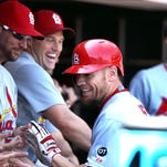 St. Louis Cardinals left fielder Brandon Moss is greeted by his teammates after his solo home run against the San Francisco Giants in the fourth inning.