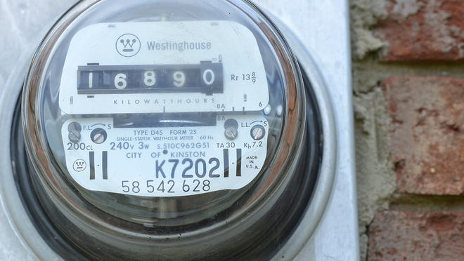 A City of Kinston utility meter runs Tuesday as residents await a decrease in thier bill and charge per kilowatt hours. Photo by Janet S. Carter / The Free Press