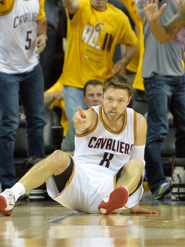 Cleveland Cavaliers guard Matthew Dellavedova (8) reacts