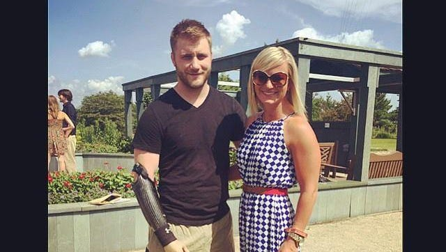 Taylor Morris and his fiance Danielle Kelly are shown in a photo posted on Facebook June 28, 2015. The couple will marry three years after an explosion in Afghanistan in May 2012 took Morris' legs, right arm and left hand.