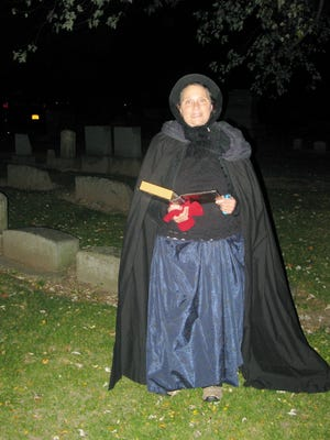 "As we walked through the dark cemetery, friendly ""spirits""appeared with eerie information on 19th century beliefs and superstitions."