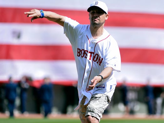 Boston Marathon bombing survivor Marc Fucarile throws out the ceremonial first pitch before the game between the Baltimore Orioles and Boston Red Sox at Fenway Park.