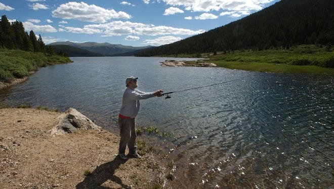 A fisherman casts a line into Long Draw Reservoir in this file photo. A multi-year project to restore the greenback cutthroat trout to 37 miles of streams that feed into the reservoir is underway.